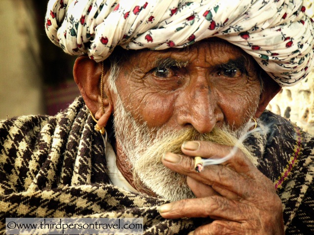 Elderly bearded and beturbaned Indian gentleman with piercing eyes